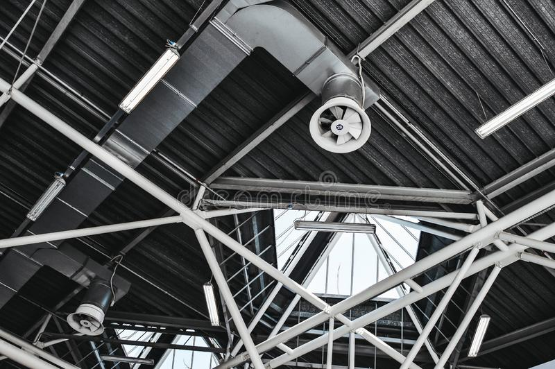 Industrial ceiling with tubes, ventilation and illumination. Met royalty free stock images