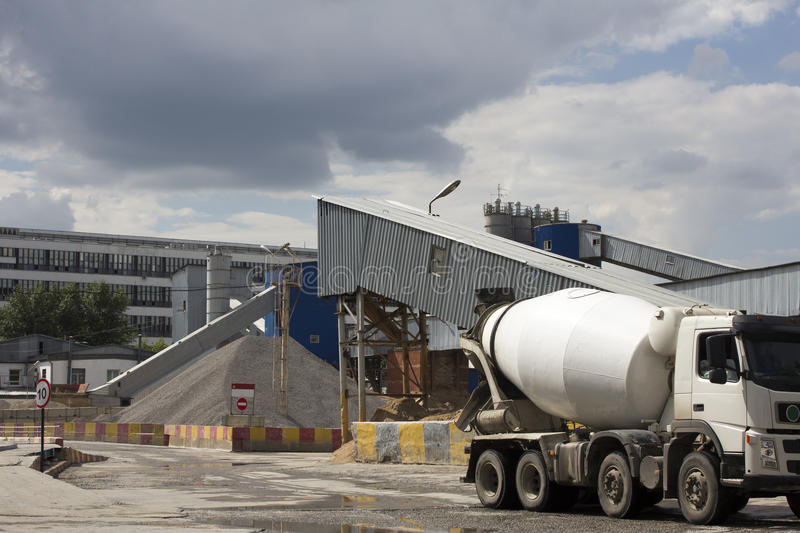 Industrial Cement Processing Plant. The foreground of a truck mixer royalty free stock image