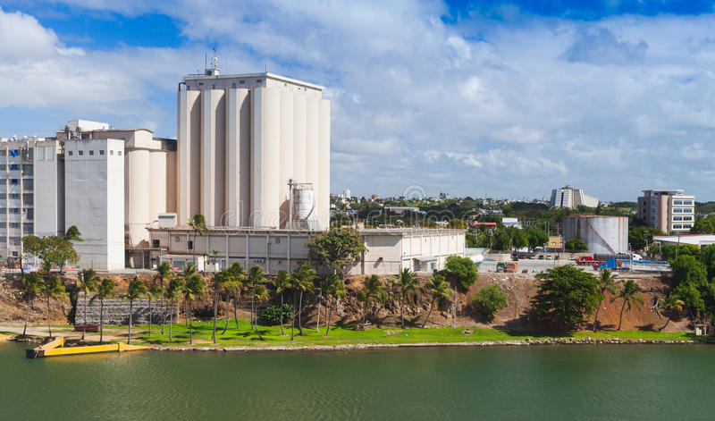 Industrial cityscape of Santo Domingo. Coast of Ozama river, industrial cityscape of Santo Domingo. Capital city of Dominican Republic stock images