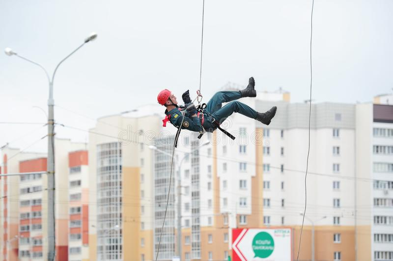 Industrial climber in helmet and uniform. Risky job. Extreme work. BELARUS, GOMEL - July 22, 2017: Competitions in industrial mountaineering. Industrial climber stock photo