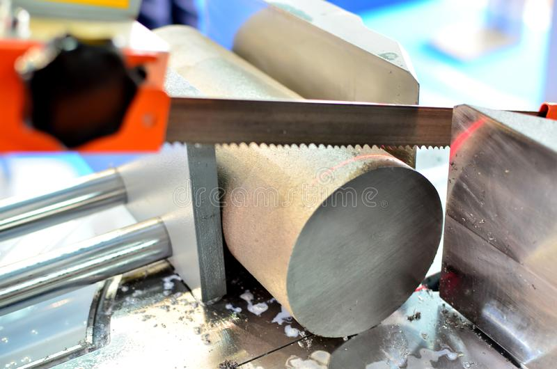 Industrial CNC lathe with band saw for cutting metal products. stock photos