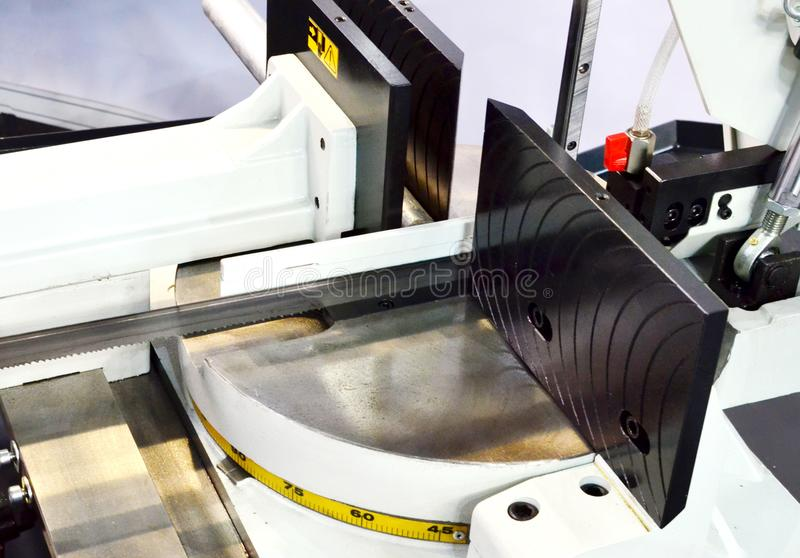 Industrial CNC lathe with band saw for cutting metal products. Industrial CNC lathe with band saw for cutting metal products. Industrial CNC lathe with band saw stock photos