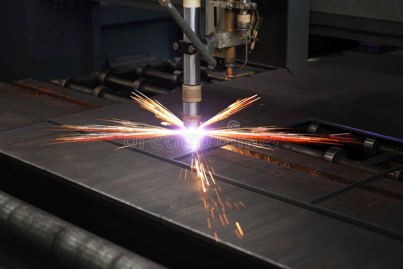 Industrial cnc plasma cutting of metal plate. And profile royalty free stock images