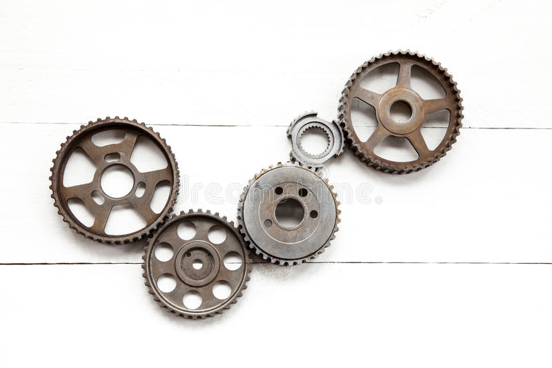 Industrial cogwheels. Cogwheels machinery , engineering and industry or concepts such as teamwork and search engine on white background stock photography