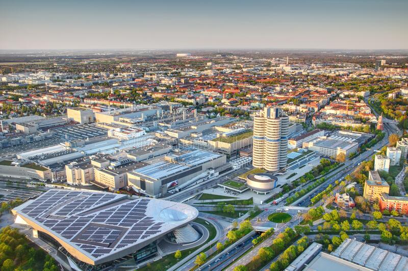 Industrial and commercial buildings in outskirts of Munich. Modern European aerial cityscape with skyscraper, industrial, commercial and residential buildings stock image