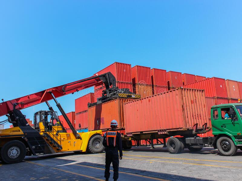 Industrial and commercial port activities, loading export import shipping cargo, Jakarta. Loading unloading logistic cargo with industrial crane. Export and royalty free stock photo
