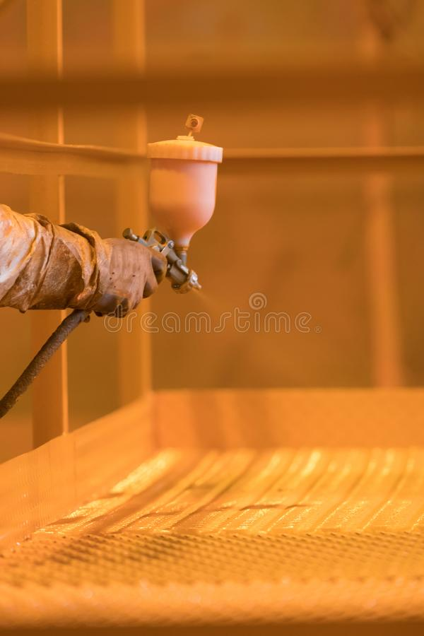 Industrial concept. A man in gloves holding a spraying device stock images