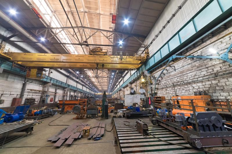 Industrial concept. An overview on construction site inside the manufacturing plate. A lot of metal details for crane royalty free stock image