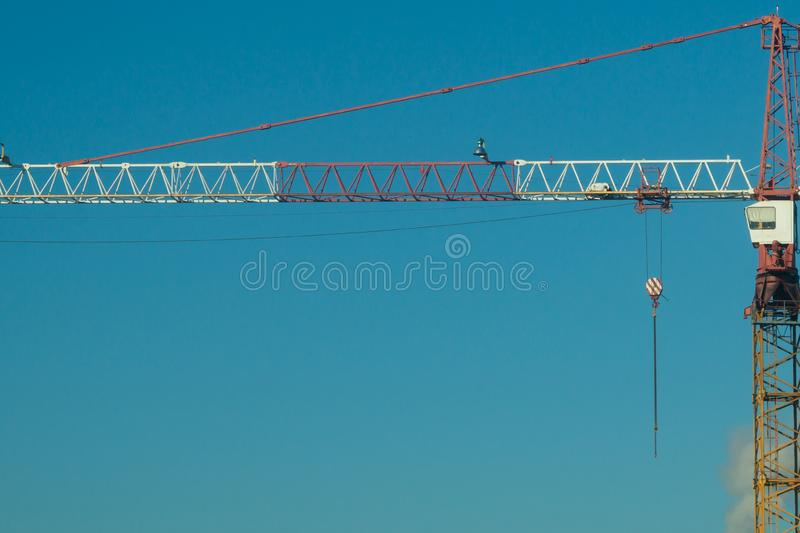 Industrial construction building crane city against a blue sky royalty free stock photography