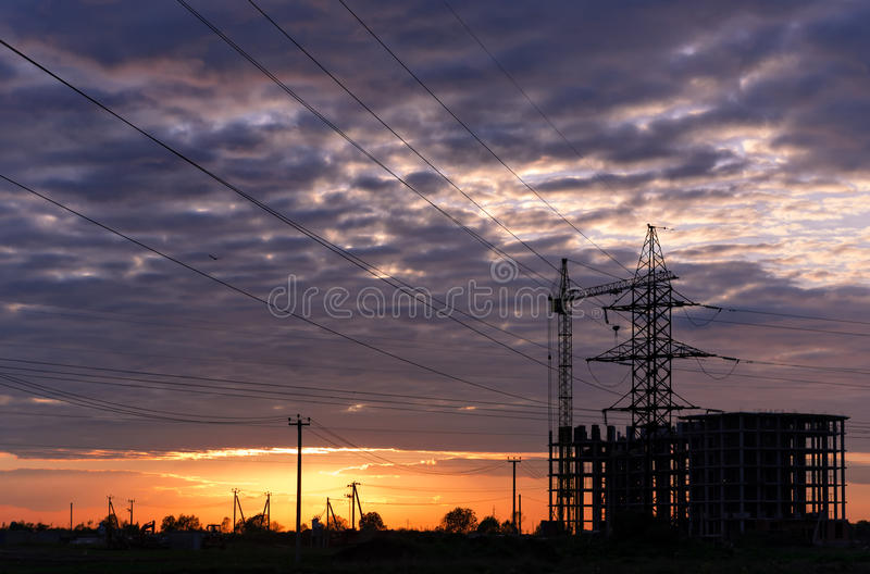 Industrial construction cranes and building silhouettes royalty free stock images