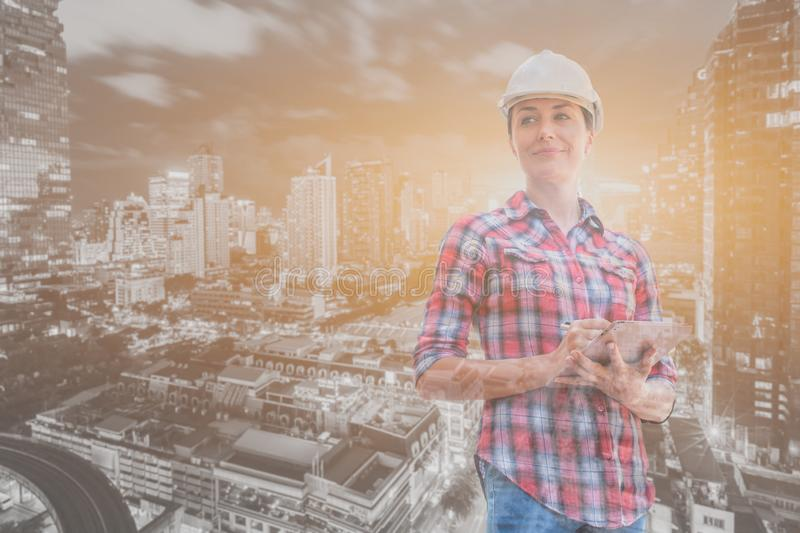 Industrial construction engineer wear safety helmet engineering working and digital tablet on building outside. Engineering tools and construction concept royalty free stock photo