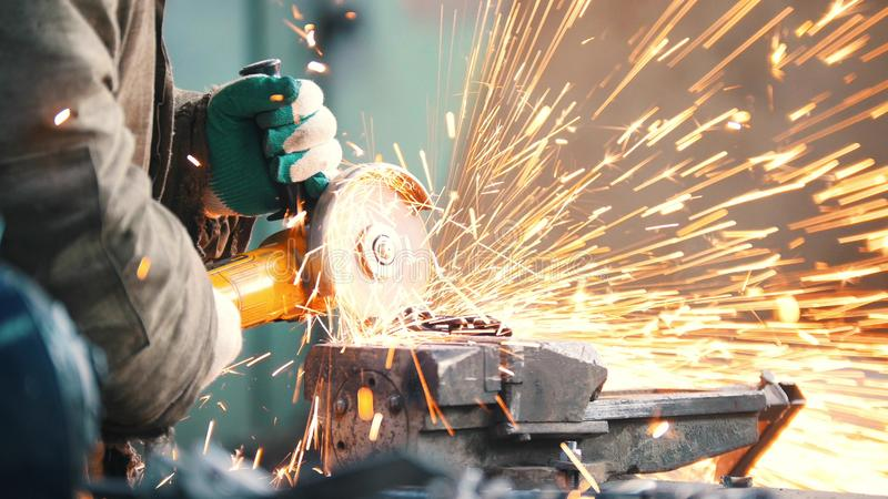 Industrial. Construction site. The man worker grinding. Fire sparkles stock images