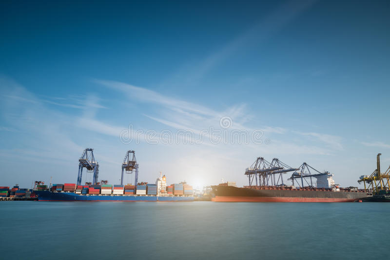 Industrial Container Cargo freight shipping by crane. Logistic Import Export in shipyard at twilight royalty free stock photography