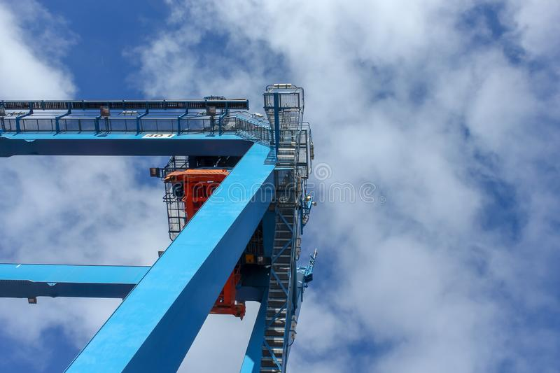 Container crane and sky with clouds stock image