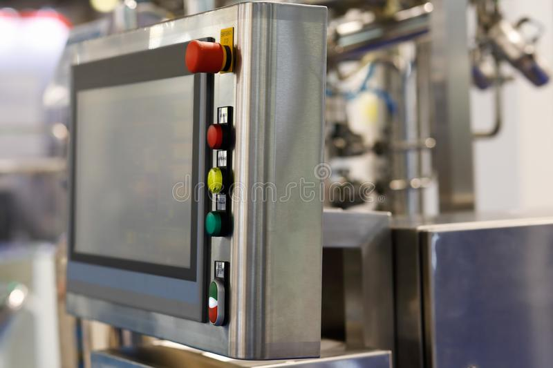 Industrial control panel with a touch screen stock image