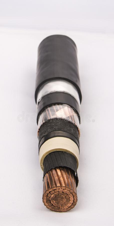 Cross section of low-voltage cable. Cross section of high-voltage cable. Thick copper veins are surrounded by a thick layer of polymer insulation steel tape royalty free stock photos