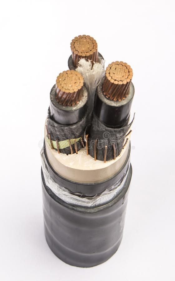 Cross section of low-voltage cable. Cross section of high-voltage cable. Thick copper veins are surrounded by a thick layer of polymer insulation steel tape stock photography