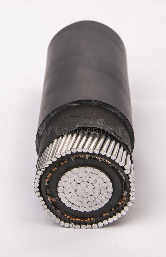 Cross section of low-voltage cable. Cross section of high-voltage cable. Thick copper veins are surrounded by a thick layer of polymer insulation steel tape stock photo