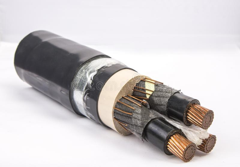 Cross section of low-voltage cable. Cross section of high-voltage cable. Thick copper veins are surrounded by a thick layer of polymer insulation steel tape stock photos
