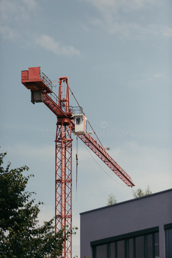 Industrial crane. Industrial high red crane working on construction stock image