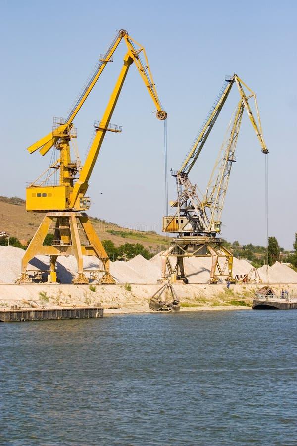 Industrial cranes in harbor royalty free stock photo
