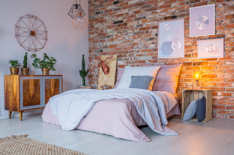 Industrial design of bedroom. Industrial design of cozy bedroom with wooden decoration royalty free stock image