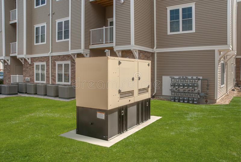 Industrial Diesel Generator. Standby generator. Diesel Generator for Office Building connected to the Control Panel with Cable Wire. Backup Generator Power stock image