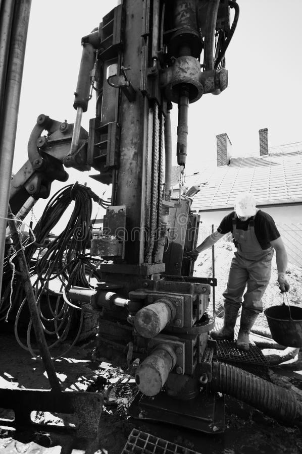 Industrial drilling machine. A large industrial drilling machine searching for a geothermal power source for private housing royalty free stock images