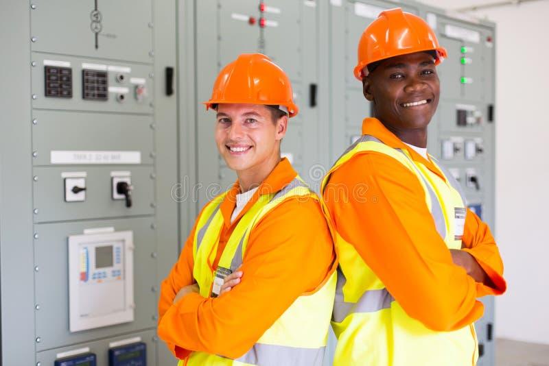 Industrial engineers arms crossed royalty free stock photos