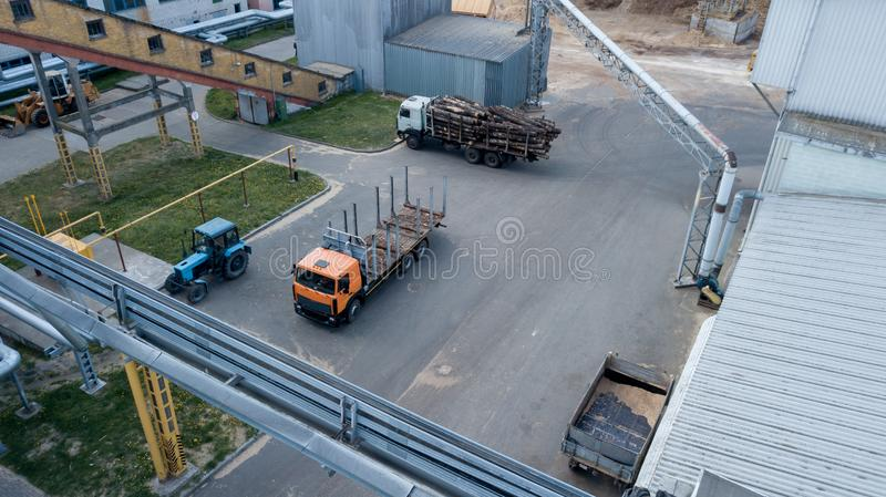 Industrial enterprise top view, truck and tractor.  royalty free stock photography
