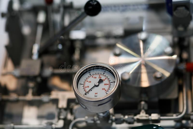 Industrial equipment with analog pressure gauge royalty free stock photos