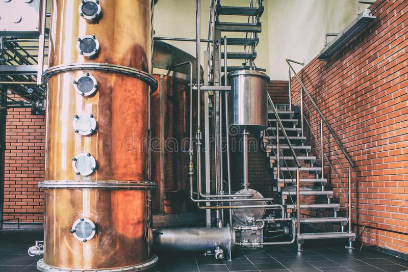 Industrial equipment for brandy production. Copper still alembic inside distiller to distill grapes and produce spirits royalty free stock images