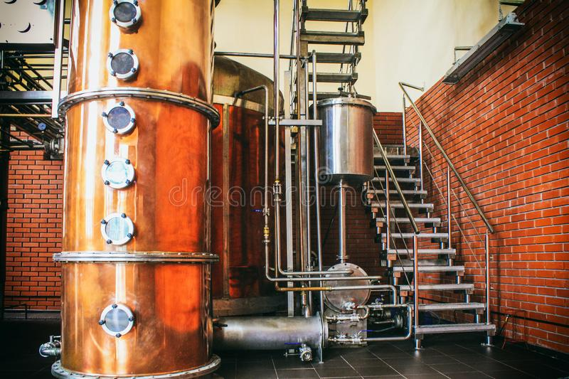 Industrial equipment for brandy production. Copper still alembic inside distiller to distill grapes and produce spirits. Noises and large grain - stylization royalty free stock photo