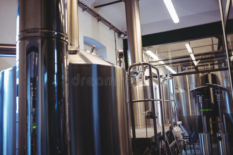 Industrial equipment at brewery. Industrial equipment at illuminated brewery stock image