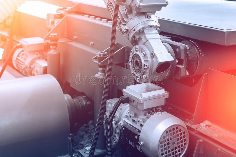 Industrial equipment close up, abstract industry manufacturing metalwork background of automated modern engine tool. Toned royalty free stock images