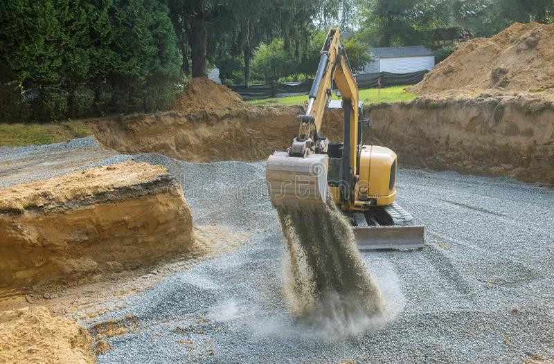 Industrial excavator for foundation building construction site, bucket details, dirt gravel royalty free stock photos