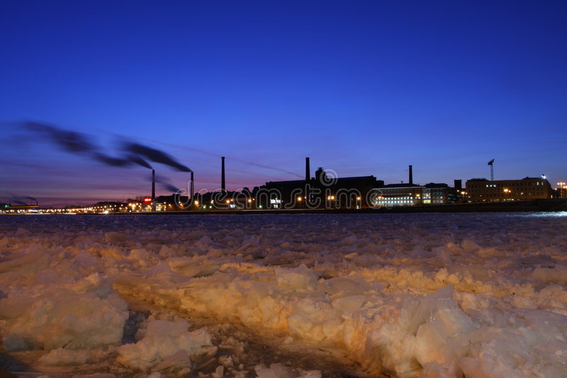 The industrial factories on river bank Neva stock photos