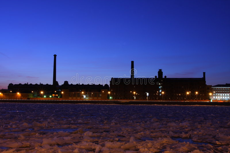 The industrial factories on river bank Neva. royalty free stock photos