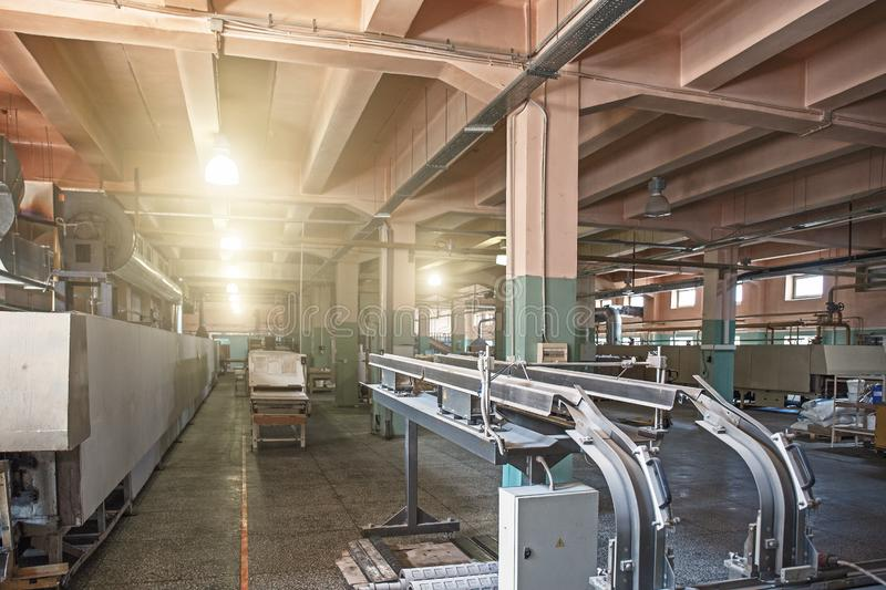 Industrial factory building or warehouse interior inside with special constructions and equipment. Toned royalty free stock photo