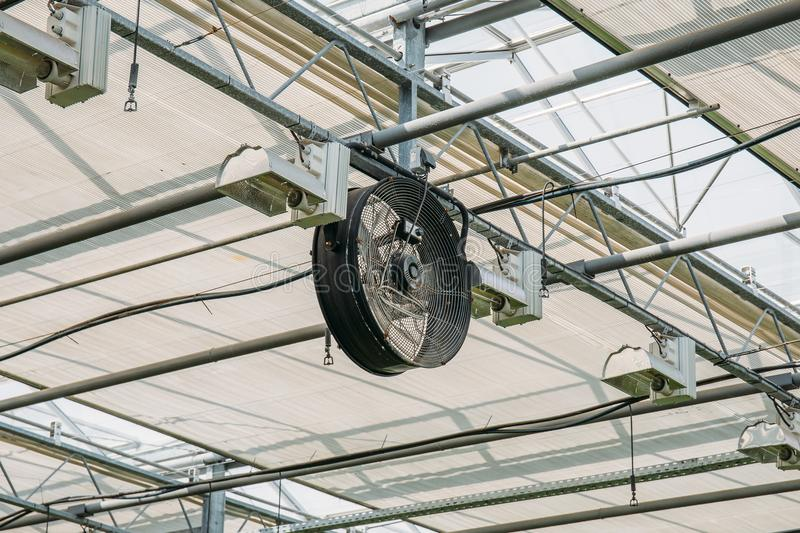 Industrial fan inside modern greenhouse, electric automation ventilation system inside glasshouse royalty free stock images