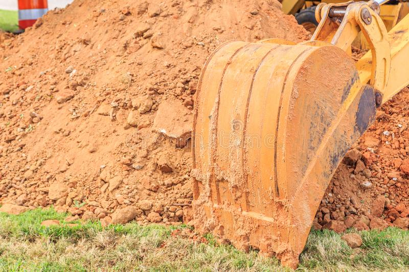 Industrial Front End Loader Bucket. In its natural state as used stock photos