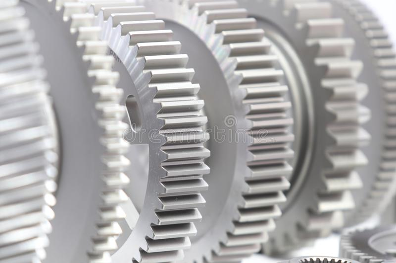 Industrial gear spare parts for heavy machine. Close up, gears, background, industry, engine, cogs, metal, mechanical, engineering, mechanism, precision stock photo
