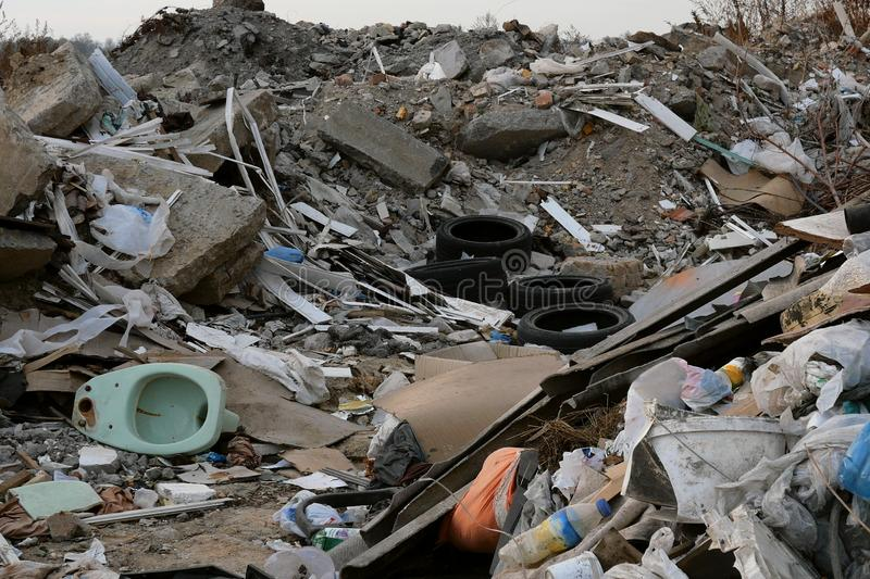 Industrial and household waste. Large garbage pile. Degraded garbage. Dirty and stink waste in trash dump or landfill. royalty free stock photography