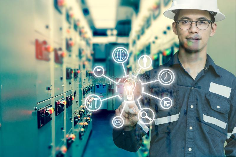 Industrial innovation technology and industry 4.0 concept. Double exposure of engineer man pointing finger with digital icon tool royalty free stock image
