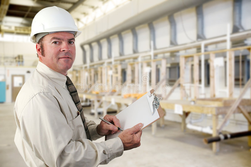 Industrial Inspector. Inpector performing an audit of a plumbing factory royalty free stock images