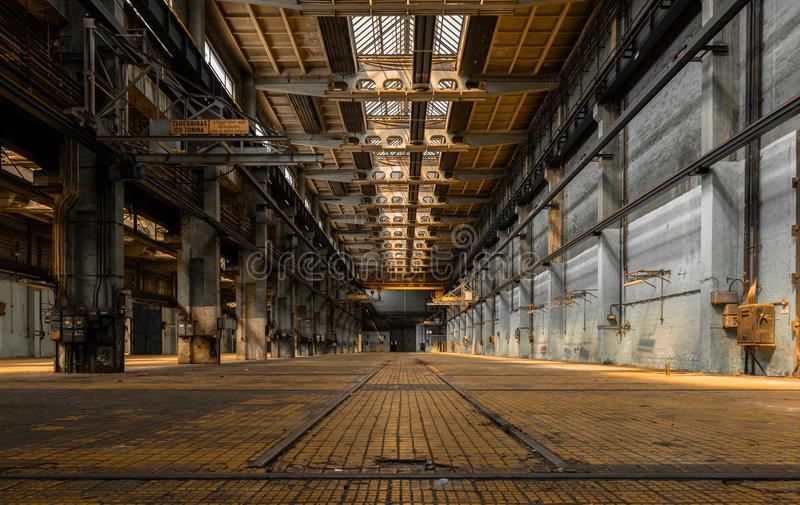Industrial interior of an old factory. Building royalty free stock photography