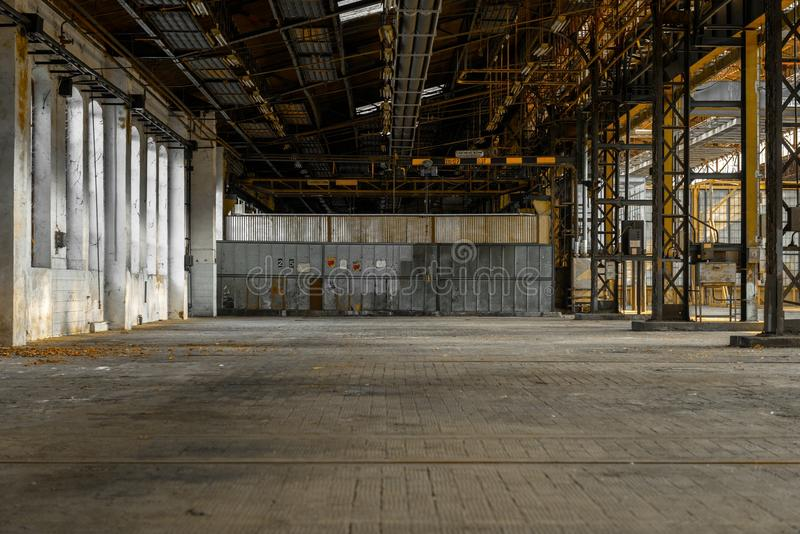 Industrial interior of an old factory. Building stock image