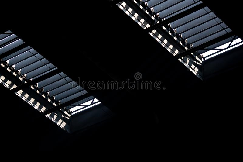 Industrial interior: upper part of window frame in factory building royalty free stock images