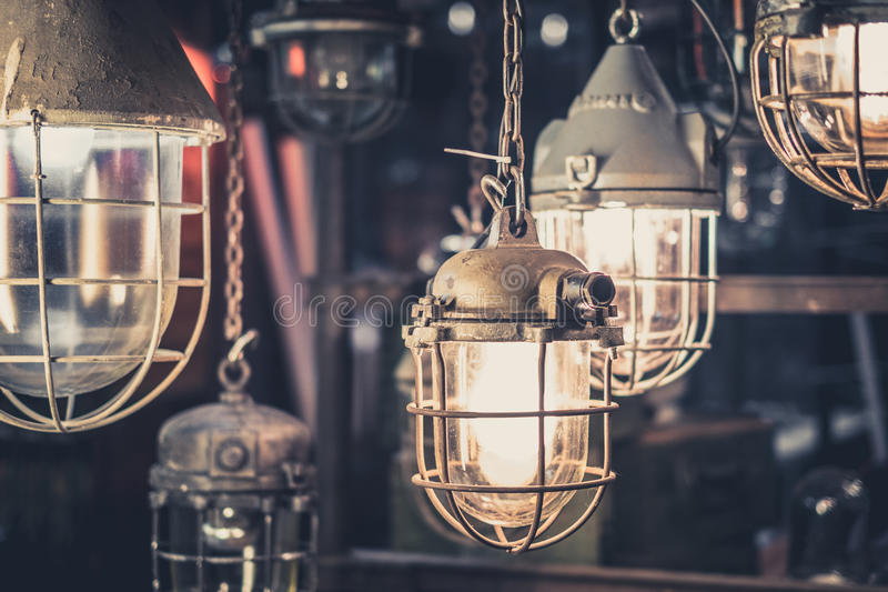 Industrial lamps, hanging lights - factory light bulbs. Industrial lamps, hanging lights , factory light bulbs stock images