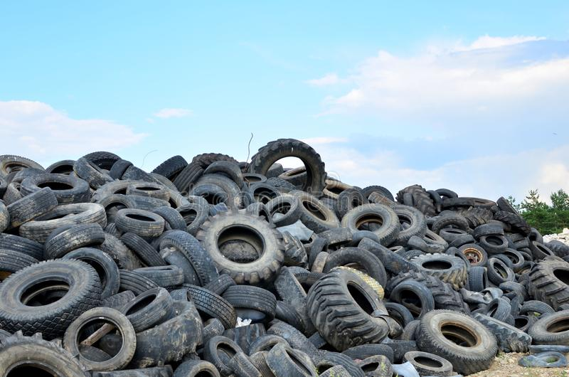 Industrial landfill for the processing of waste tires and rubber tyres. stock photos